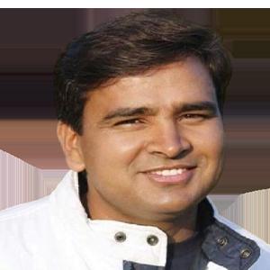 Division Commissioner Surendra Singh